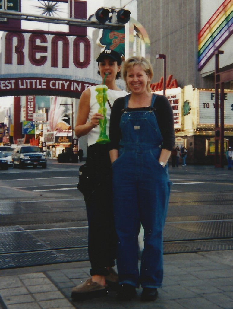 "Me and Dee Dee under the Reno ""Biggest Little City in the World"" sign, circa mid 90s. Not my platformed Birkenstocks, Negro-league cap and hurricane-type cocktail"