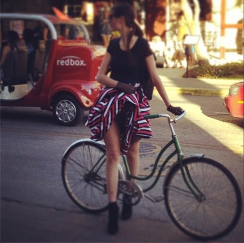 sxsw girl in skirt on bike