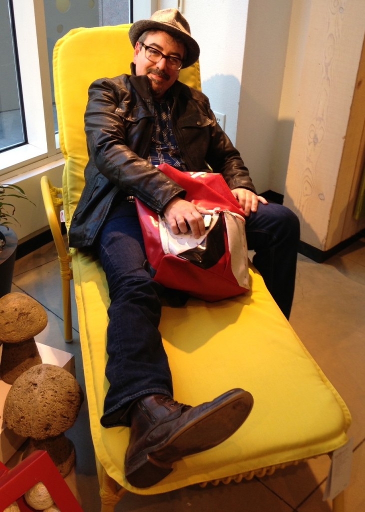 Silvo lounging at Crate & Barrel with his Freitag Bag full of pads and pens.