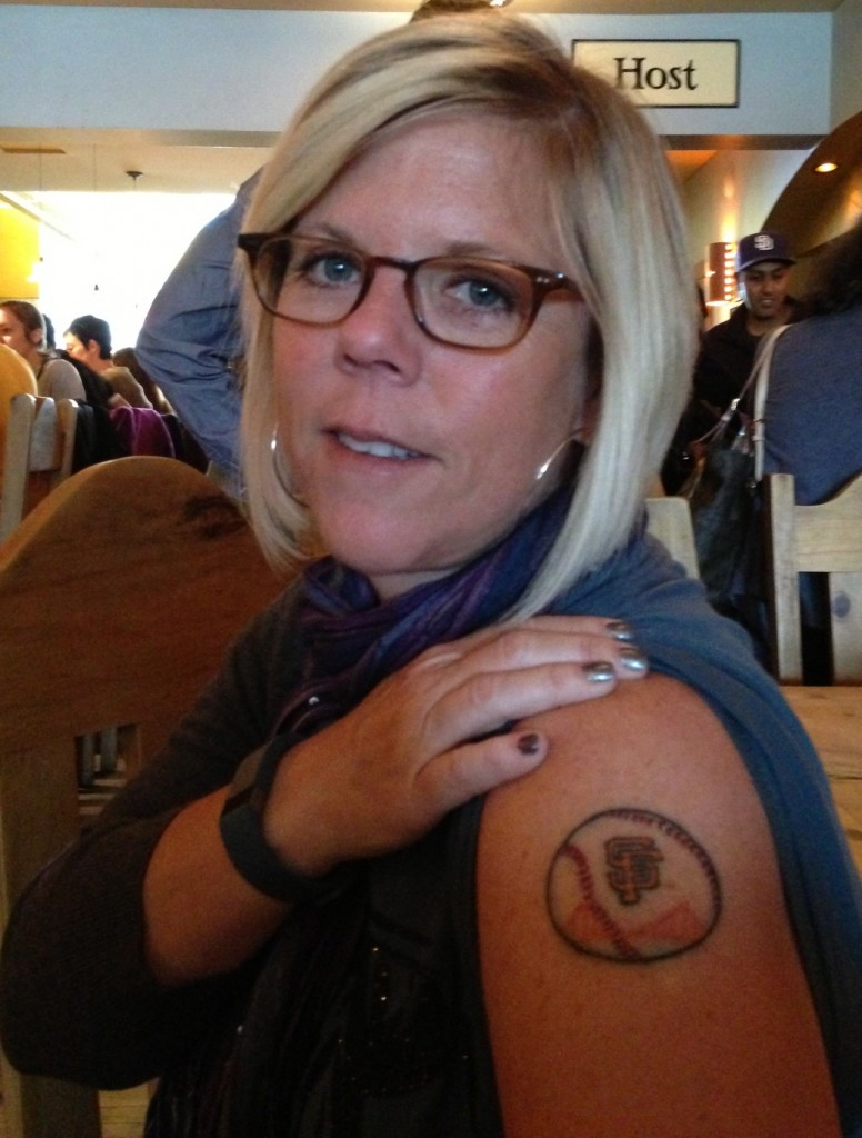 "Kell and her recent ""San Francisco Giants"" tattoo."