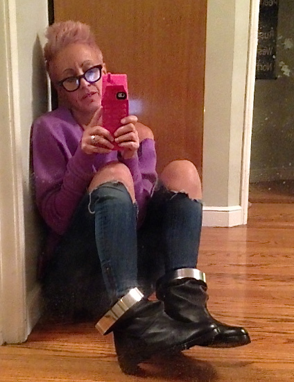 Me in my new Pierre Hardy Gravity Boots. Note my new giant phone case by Moschino.