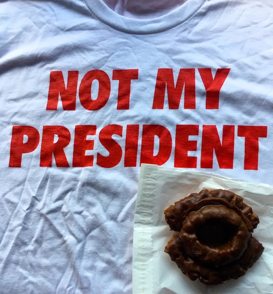 "Sometimes it's the little things. ""NOT MY PRESIDENT"" T-shirt from 63 Bluxome Gallery, chocolate old-fashioned from Donut World."