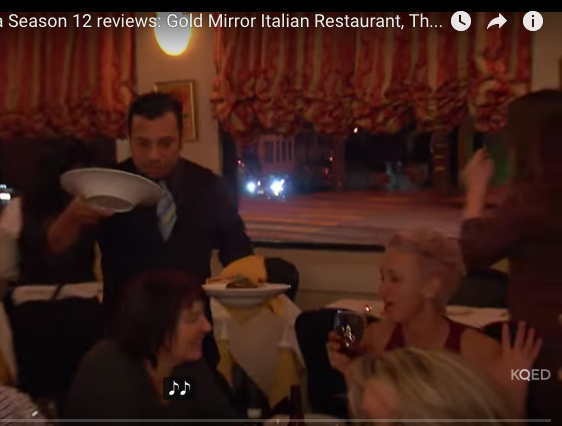 """That's me with the glass of red wine and the """"jazz hand"""" at the Gold Mirror in San Francisco."""